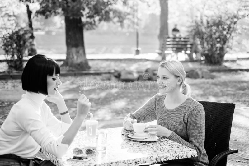 Female frienship. Relax with coffee. gossip concept. happy breakfast. coffee time. free time with joy. bisiness meeting. Cafe terrace. happy friends girls royalty free stock images