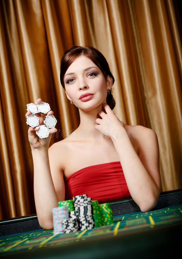 Female gambler keeps chips in hand royalty free stock photos