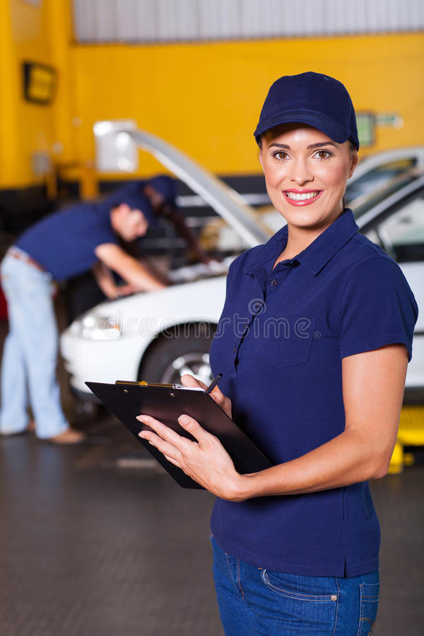 Female garage receptionist royalty free stock image