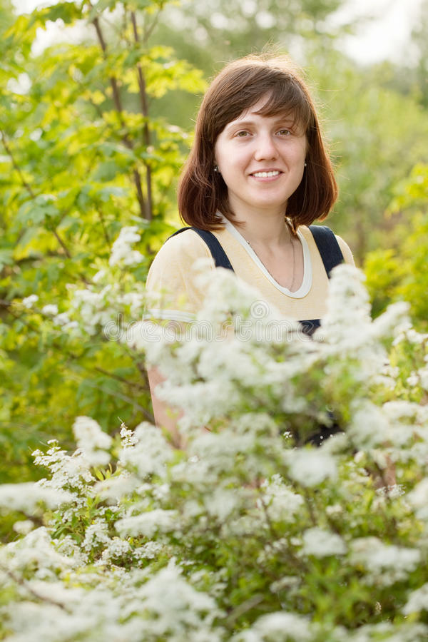 Female gardener in meadowsweet plant royalty free stock image
