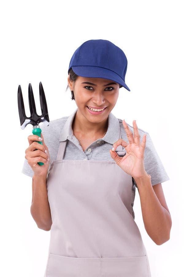 Female gardener showing ok hand sign gesture. White isolated background royalty free stock photos