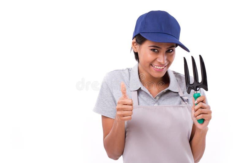 Female gardener showing thumb up gesture. White isolated background stock photos