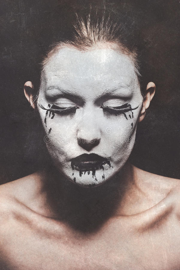 Female ghost. A female ghost with white corpse paint stock image