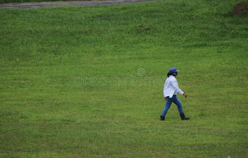 Female golf ball collector in the Philippines. Female golf ball collector in the Haciendas de Naga in Naga City Camarines Sur, Philippines royalty free stock photo