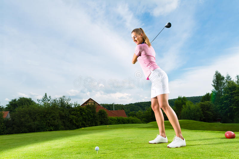 Download Female Golf Player On Course Doing Golf Swing Stock Image - Image: 26869185