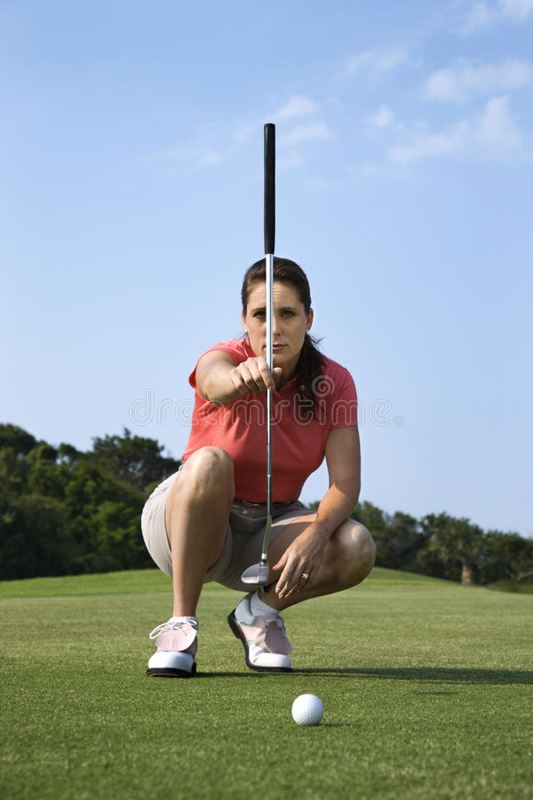 Female Golfer Concentrating stock images