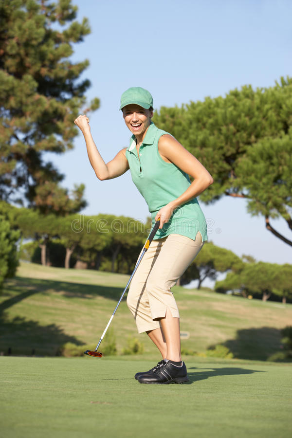 Lovely Blonde Female Golfter Enjoying A Round Of Golf On A