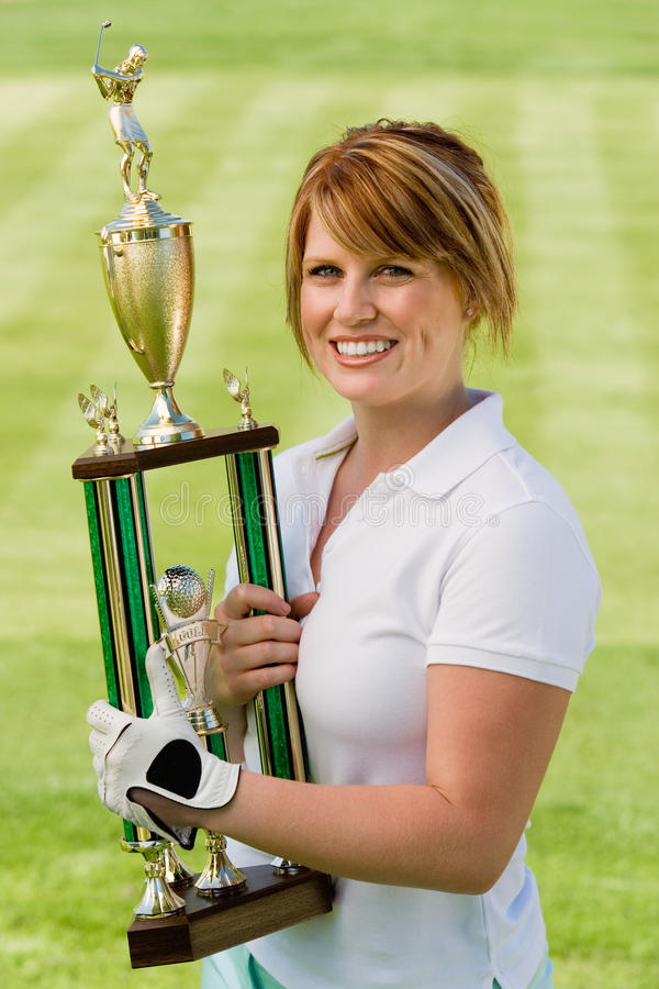 Female Golfer Holding Trophy royalty free stock images