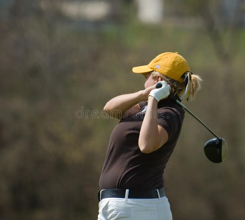 Female golfer side view royalty free stock photos
