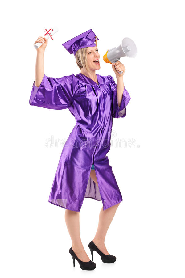 Female graduate student speaking on a megaphone royalty free stock images