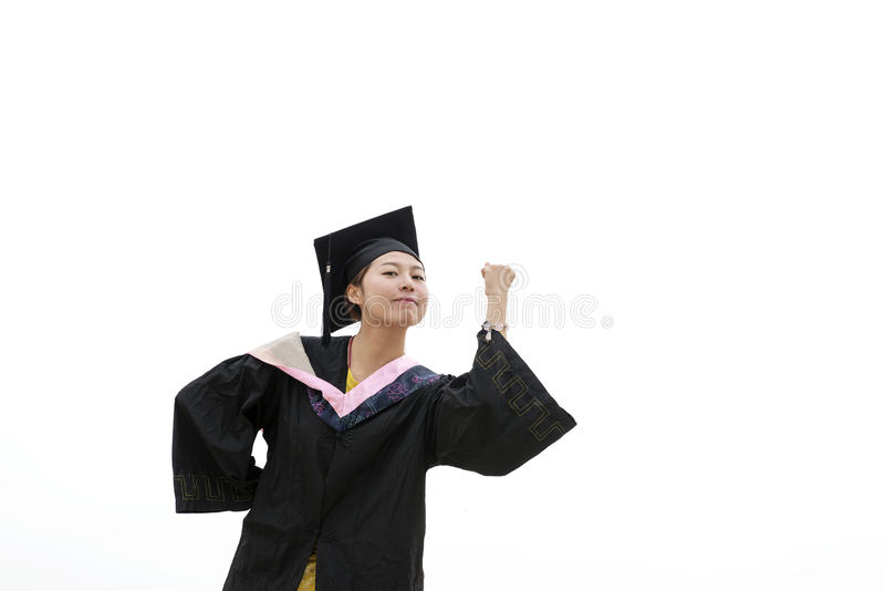 Female graduate wearing graduation gown stock photo