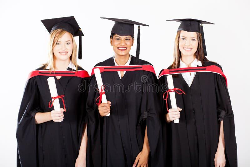 Female graduates. Group of female graduates at graduation stock images