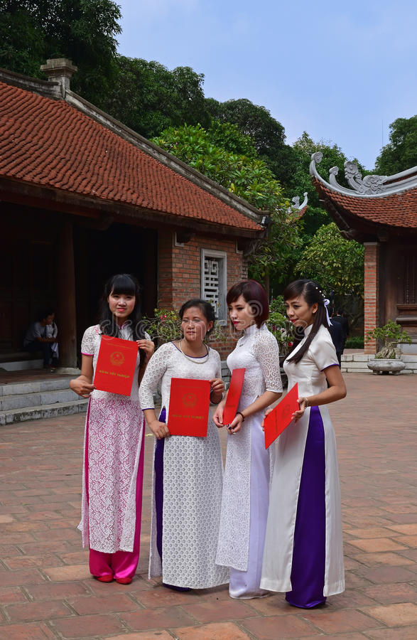 Female graduates posing for their graduation in traditional Vietnamese attire, Ao Dai. This image is taken in Temple of Literature, Hanoi during the graduation royalty free stock images