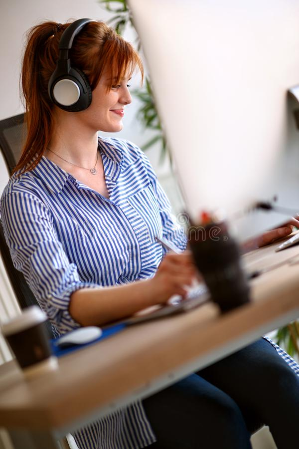Female on job in office stock photography