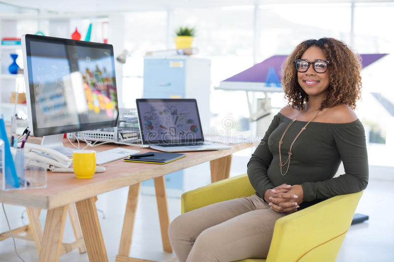 Female graphic designer working at desk. In the office royalty free stock photo