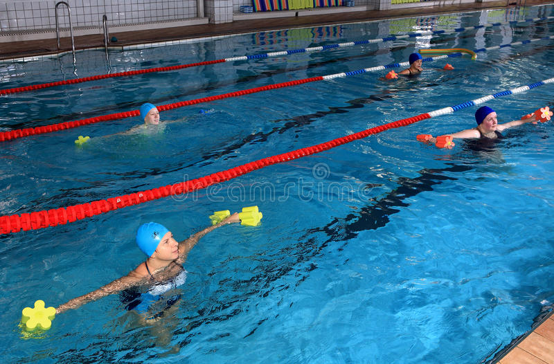 Female group training in the indoor swimming pool, editorial use. RUSSIAN FEDERATION, SAINT PETERSBURG - OCTOBER 24, 2013: Joint training a group of women in the stock image