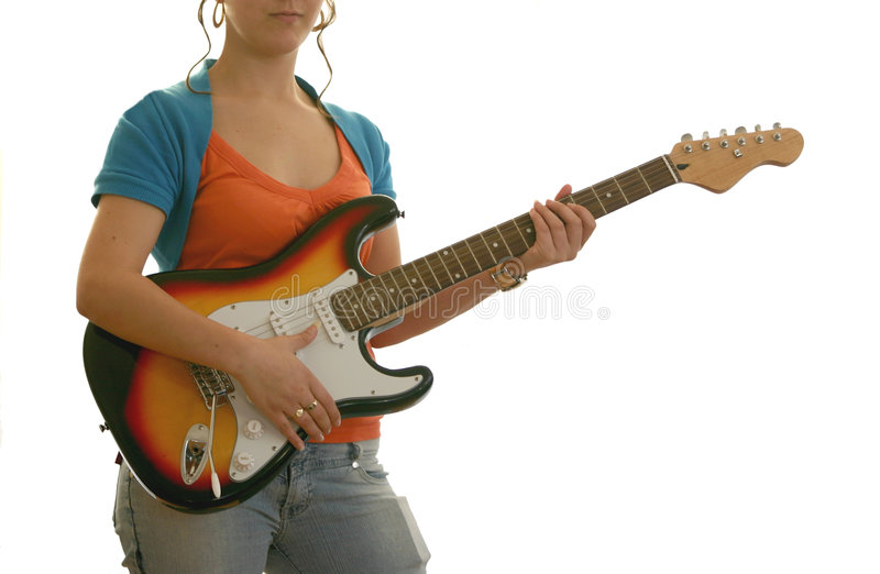 Female guitarist. Playing electric guitar royalty free stock photography