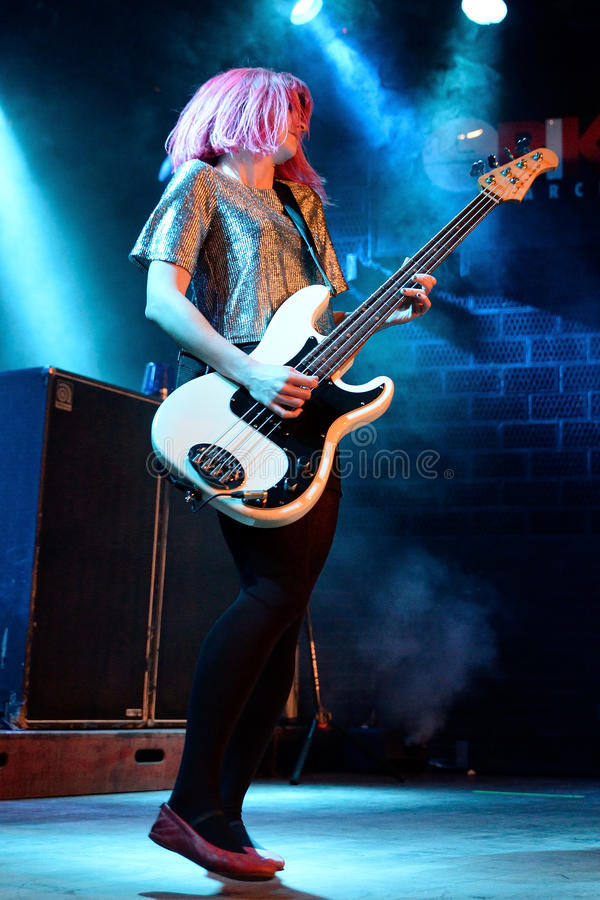 The female guitarist of The Subways (rock band) performs at Bikini stage stock images