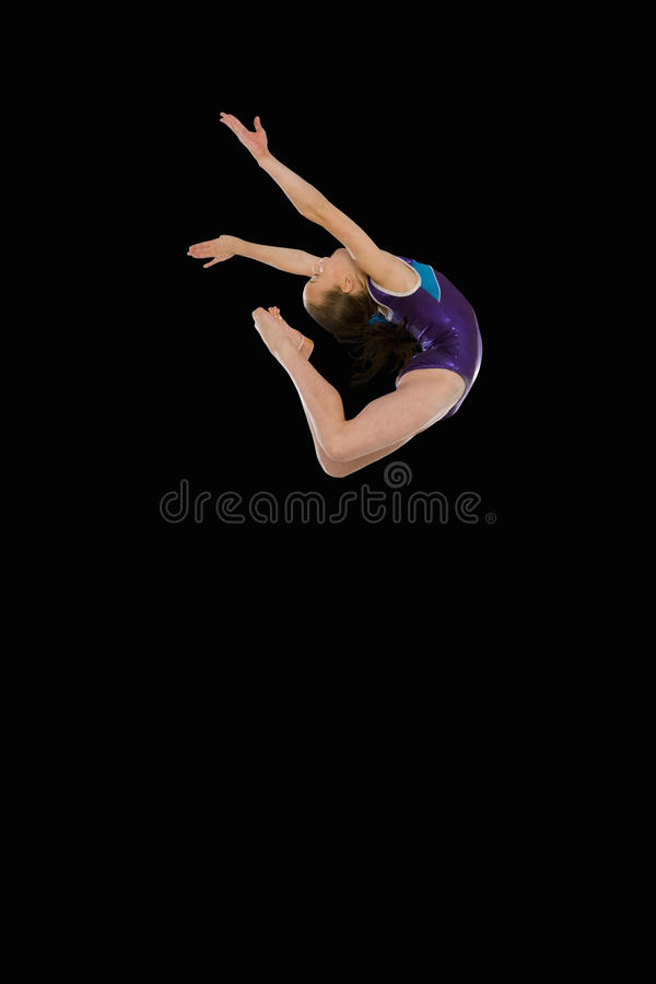 Female gymnast in air, low angle view royalty free stock photo