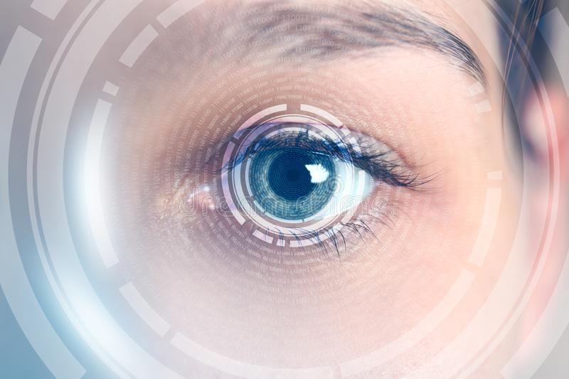 Female hacker with iris scanning, closeup. Concept of digital crime stock photography