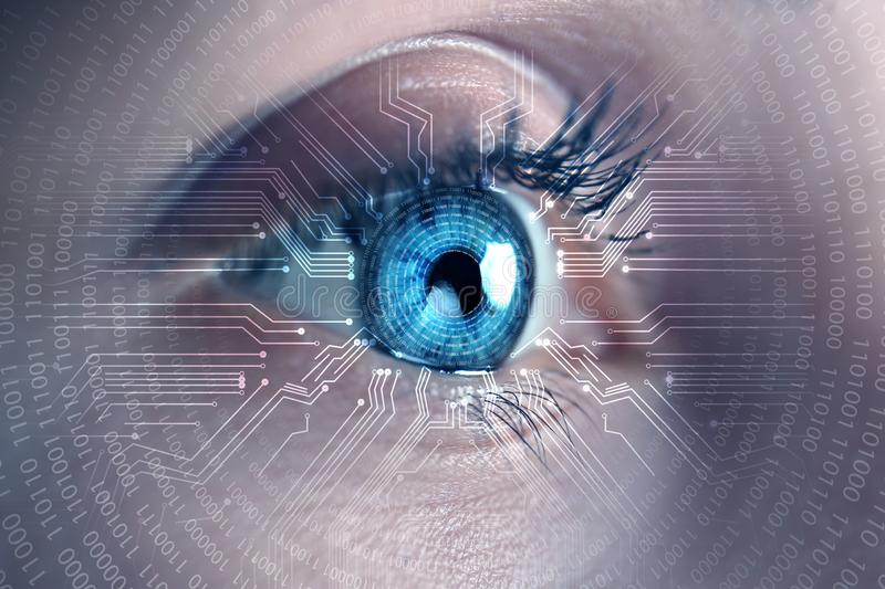Female hacker with iris scanning, closeup. Concept of digital crime stock images