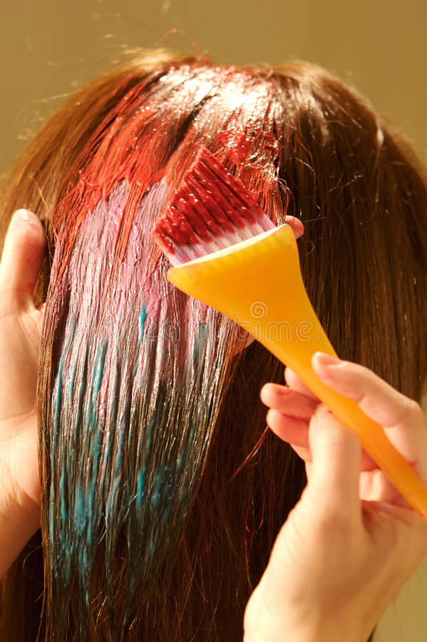 Female hair coloring at a salon. An image of a Female hair coloring at a salon stock photos