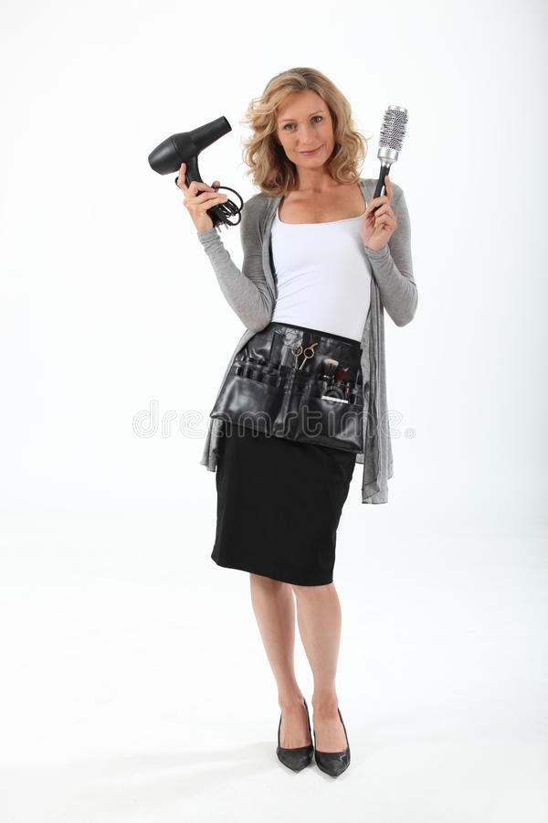 Female hairdresser stock photos