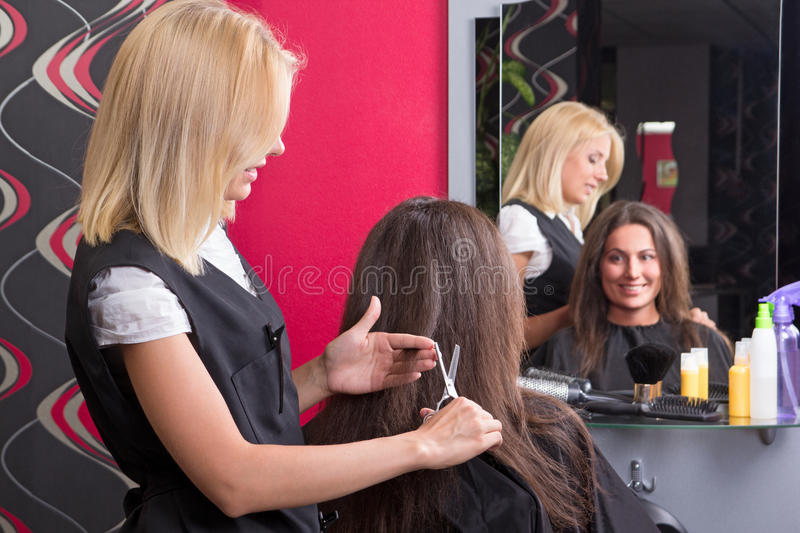 Female Hairdresser Makes Hairstyle For Beautiful Girl Royalty Free Stock Photography