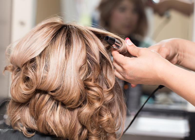 Female Hairstyles on curling in a beauty salon royalty free stock photography