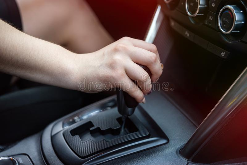 Female hand on automatic transmission car lever. royalty free stock photo