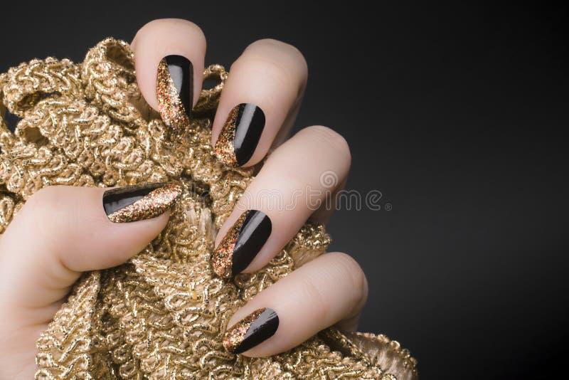 Golden black nails stock photo