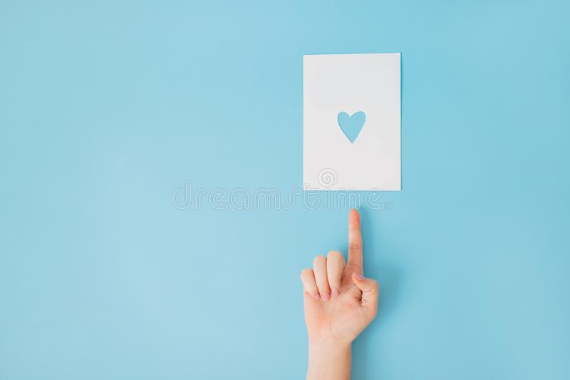 Female hand on a blue background pointing up. royalty free stock images