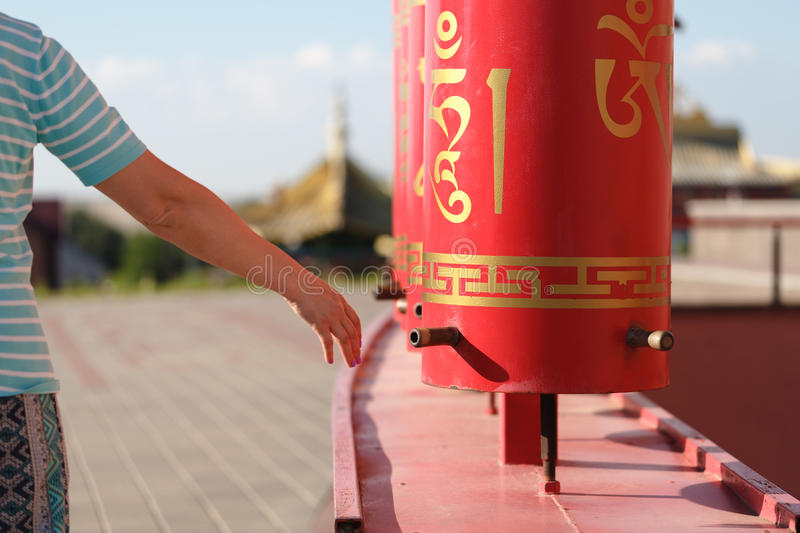 Female hand on the buddhist prayer drum royalty free stock photography