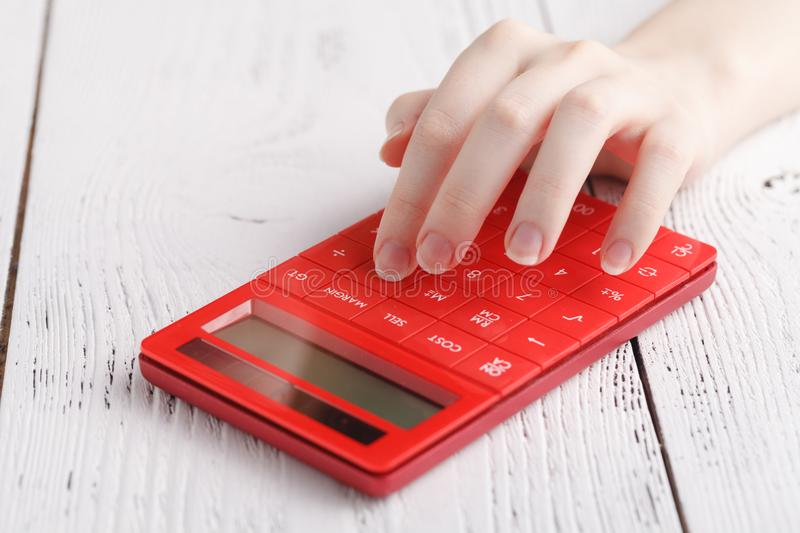 Female hand with calculator royalty free stock photos