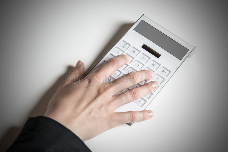 Female hand with calculator royalty free stock photo