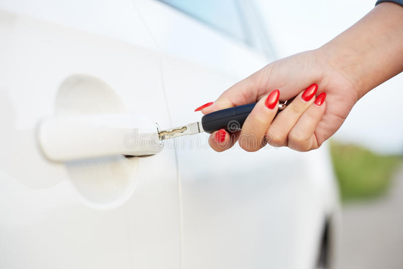 Female hand with car keys. Female hand holding key and opening car door stock image