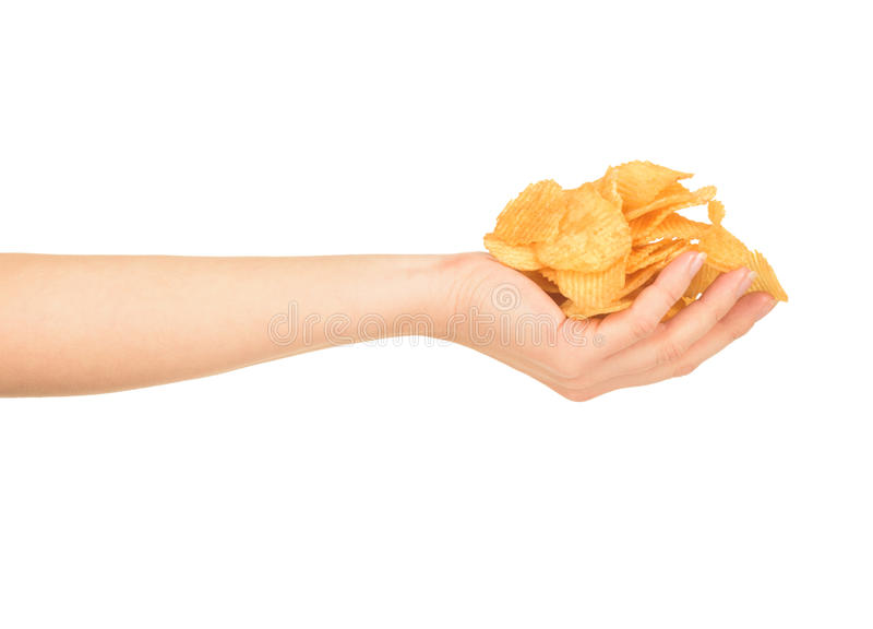 Female hand with chips royalty free stock photography