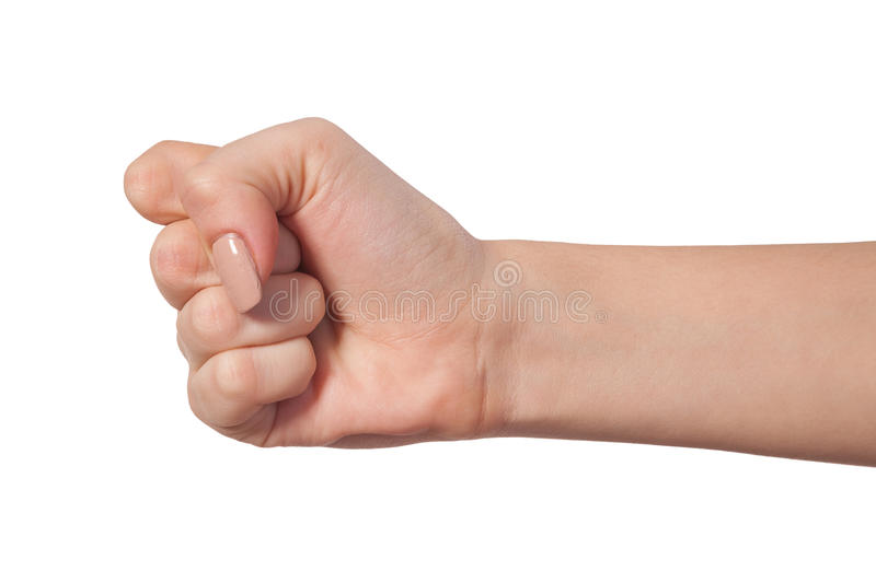 Female hand with a clenched fist isolated. Hand with clenched a fist, isolated on a white background stock images