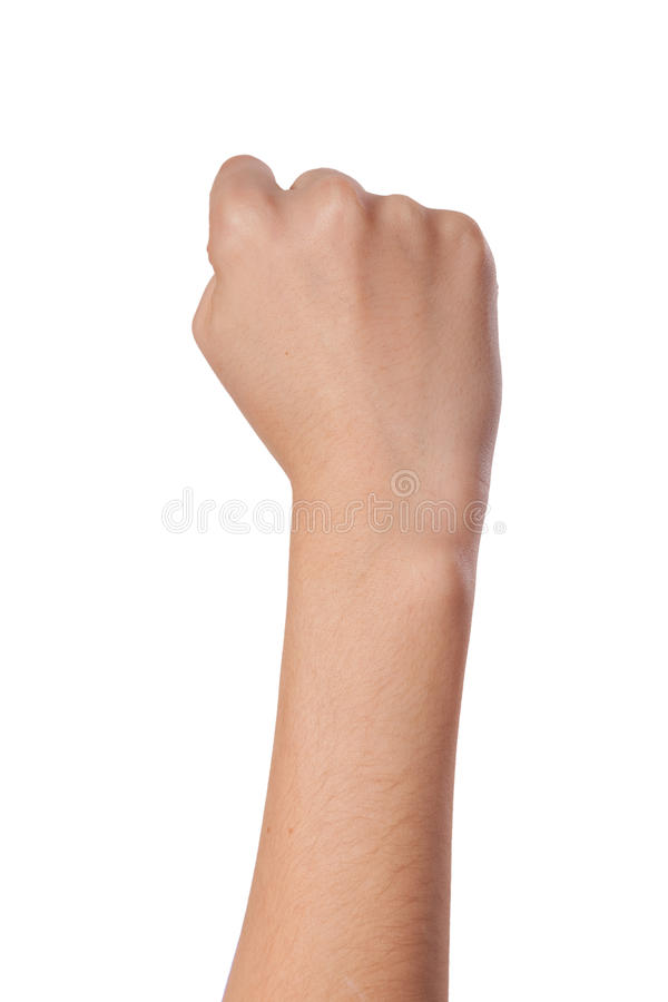 Female hand with a clenched fist isolated. Hand with clenched a fist, isolated on a white background royalty free stock images