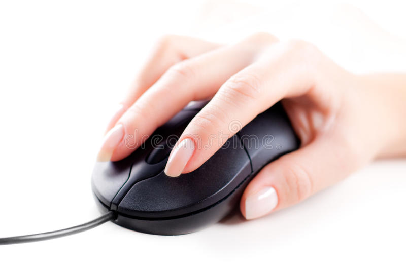 Female hand on computer mouse stock photography
