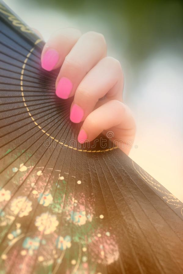 Female hand with a fan stock image