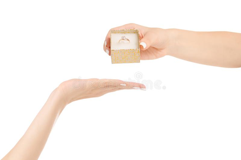 Female hand gives a box with a gold ring royalty free stock photography