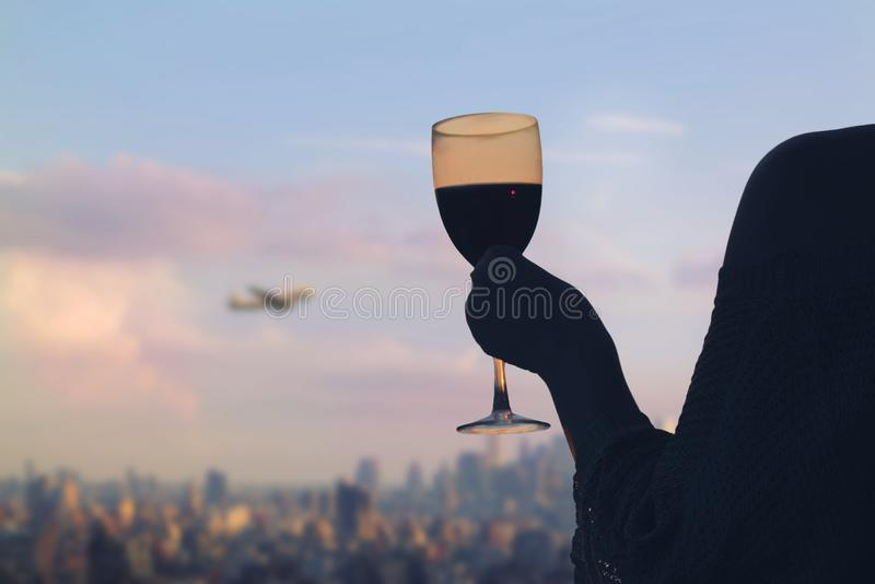 Female hand with glass of wine on Manhattan background. New York city. stock photography