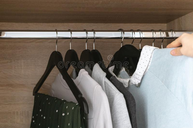 Female hand hangs clothes royalty free stock photo