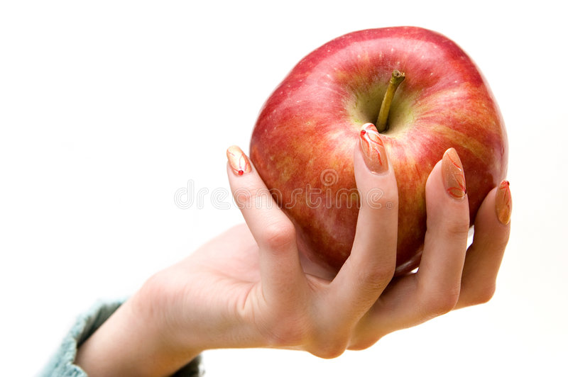 Female hand holding an apple isolated on white royalty free stock photography