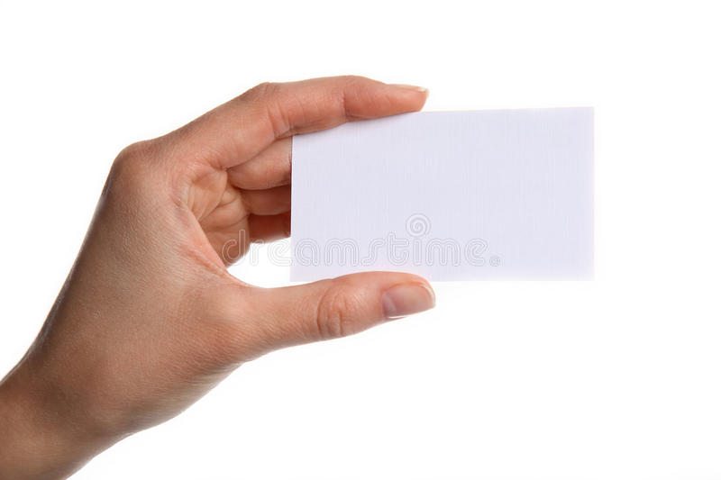 Female hand holding a blank business card, isolated on white background royalty free stock photo