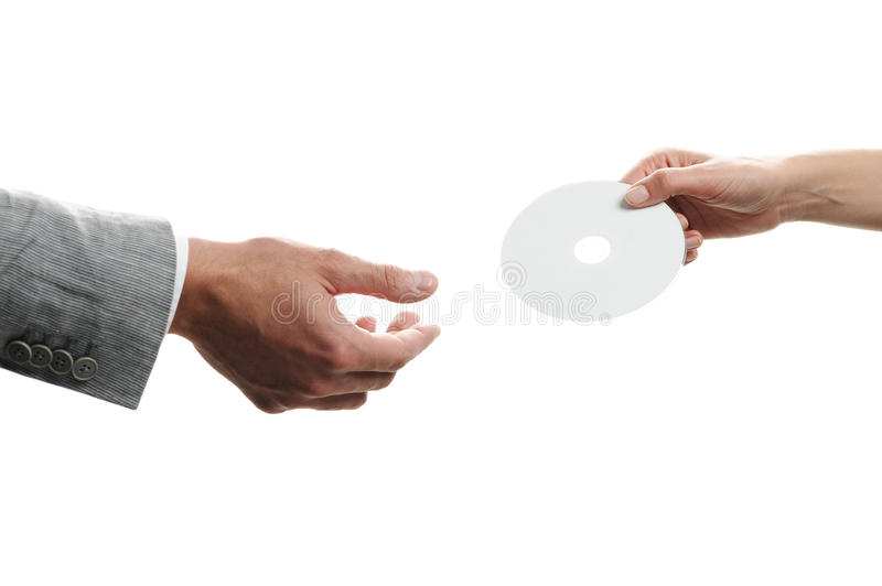 Female hand holding a blank disc royalty free stock photo