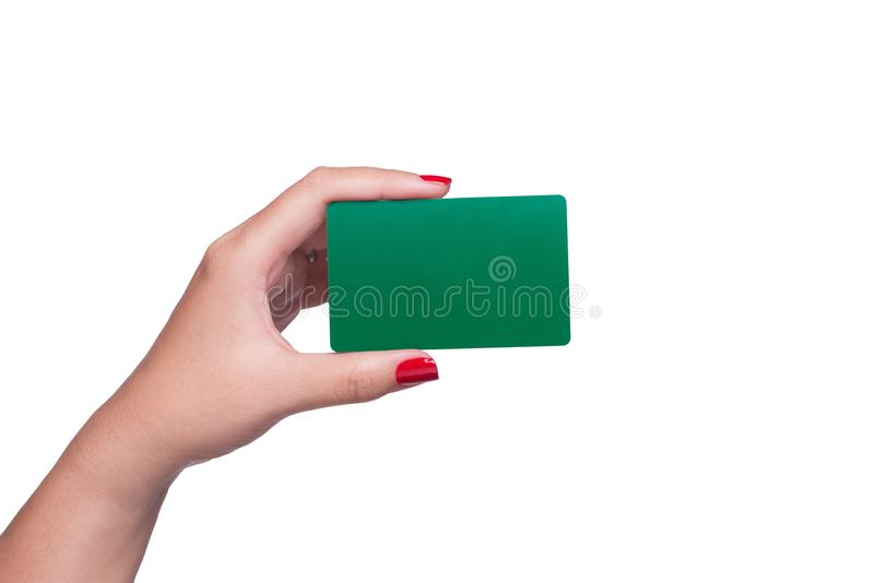 Female hand holding blank green card isolated on white background. royalty free stock photo