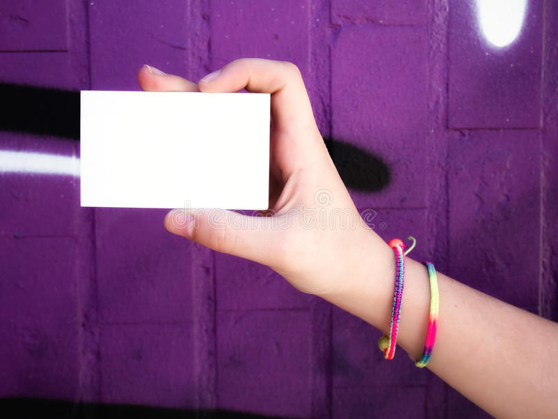 Female hand holding blank white business card. stock photos