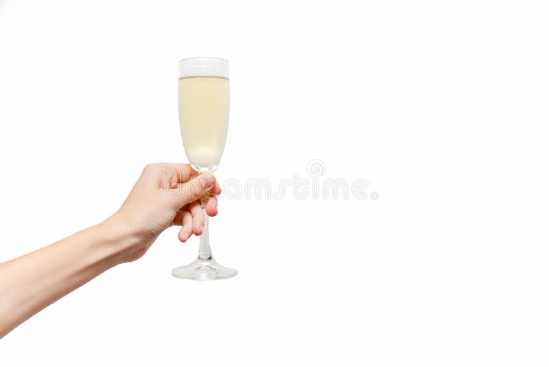 Female hand holding champagne glass. Holiday royalty free stock photography